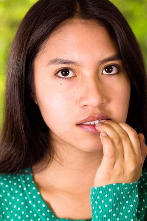 closeup of an anxious girl bitting nails Stock Photo
