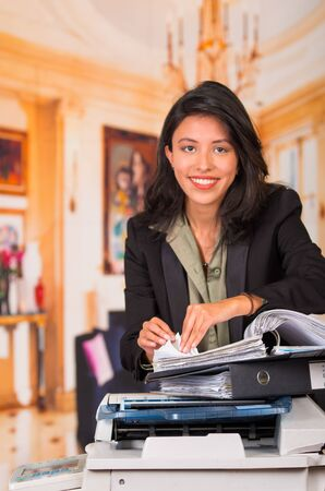 fotocopiadora: Young smiling businesswoman Using Copy Machine At The Office