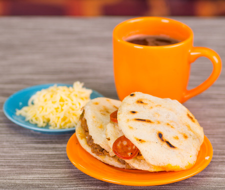 Traditional delicious arepas, shredded chicken avocado and cheddar cheese and shredded beef