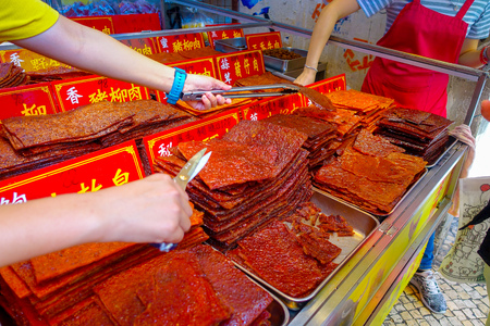 MACAU, CHINA- MAY 11, 2017: Delicious chinese food, dried meat slice