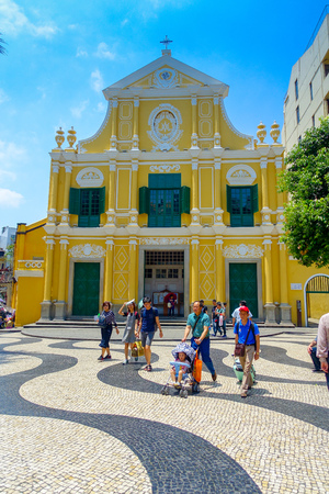 the abbot: MACAU, CHINA- MAY 11, 2017: An unidentified people walking around of the beautiful St. Dominic Church at Macao. St. Dominic is a medieval church in the old town of Macao