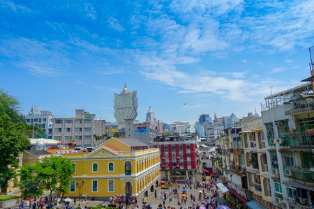 entertainment center: MACAU, CHINA- MAY 11, 2017: Macau city with buildings and behind the iconic hotel Grand Lisboa is a very big hotel and restaurant, also the oldest casino in Macau city Editorial
