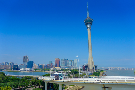 MACAU, CHINA- MAY 11, 2017: Famous traveling Macau Tower, urban ladscape near river in macao asia