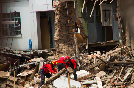 Quito, Ecuador - December 09, 2016: An unidentified group of firemans, cleaning the damage building