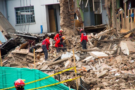heat loss: Quito, Ecuador - December 09, 2016: An unidentified group of firemans, Damage and destruction in building After Fire Inferno