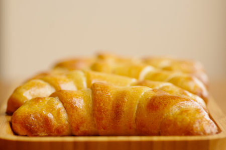 Delicious, fresh, crunch and tasty baked croissants on wooden table