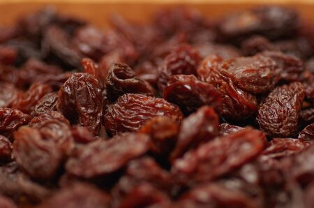raisin: Delicious raisins as background Grape Raisin texture