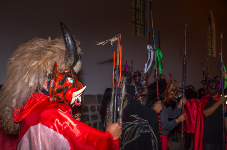 Quito, Ecuador - May 27, 2015: An unidentified group of people dressed up as devil in the diablada