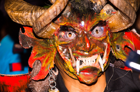 Quito, Ecuador - february 02, 2016: Close up of an unidentified man dressed up participating in the Diablada, popular town celebrations with people dressed as devils dancing in the streets