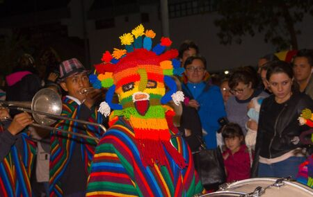 Quito, Ecuador - february 02, 2016: An unidentified man dressed up participating in the Diablada, with a colorful mask in his head