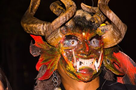 Quito, Ecuador - february 02, 2016: Close up of an unidentified man dressed up as devil Editorial