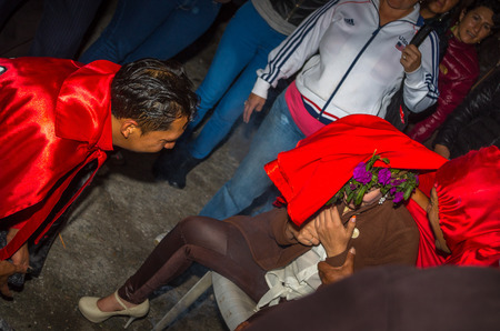 Quito, Ecuador - May 27, 2015: Close up of an unidentified man dressed up as devil in the diablada