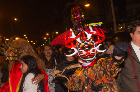Quito, Ecuador - february 02, 2016: An unidentified people dressed up participating in the Diablada, popular town celebrations with people dressed as devils dancing in the streets