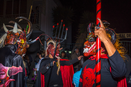 Quito, Ecuador - May 27, 2015: An unidentified group of people dressed up as devil in the diablada using a Trident in their hands
