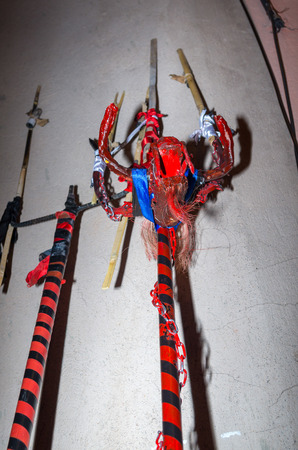 Quito, Ecuador - May 27, 2015: Close up of a trident posing in a white wall in the diablada