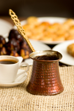 Delicious mediterranean breakfast, cup of coffee and fresh blurred bread Stock Photo