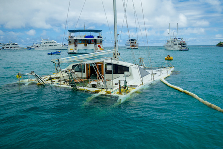 the sunken: Sunken sailboat in Galapagos in a beautiful blue water Stock Photo