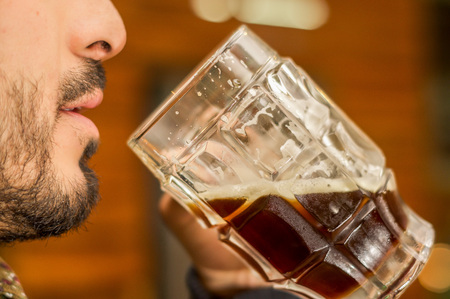 Man drinking a dark beer, delicious craft beer Booze Brew Alcohol Celebrate