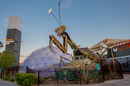 LAS VEGAS, NV - NOVEMBER 21, 2016: Giant Praying Mantis Sculpture in front of Container park in Downtown Las Vegas the three story Container Park is made from shipping containers