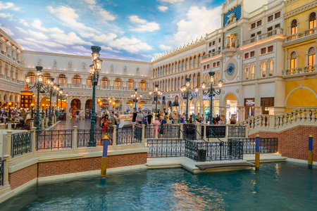 nv: LAS VEGAS, NV - NOVEMBER 21, 2016: An unidentified people walking in the plaza of the Venetian hotel replica of a Grand canal in Las Vegas with more than 4000 suites it s one of the most famous hotels in the world Editorial