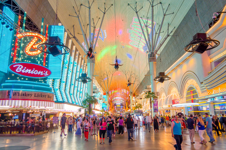 nv: LAS VEGAS, NV - NOVEMBER 21, 2016: An unidentified people walking at the famous Fremont Street, Nevada, with a light show. The street is the second most famous street in the Las Vegas. Fremont Street dates back to 1905, when Las Vegas was founded