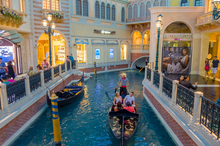 lasvegas: LAS VEGAS, NV - NOVEMBER 21, 2016: An unidentified people walking in the plaza and using the gondola of the Venetian hotel replica of a Grand canal in Las Vegas with more than 4000 suites it s one of the most famous hotels in the world