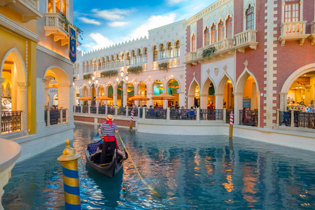 LAS VEGAS, NV - NOVEMBER 21, 2016: An unidentified people walking in the plaza and using the gondola of the Venetian hotel replica of a Grand canal in Las Vegas with more than 4000 suites it s one of the most famous hotels in the world