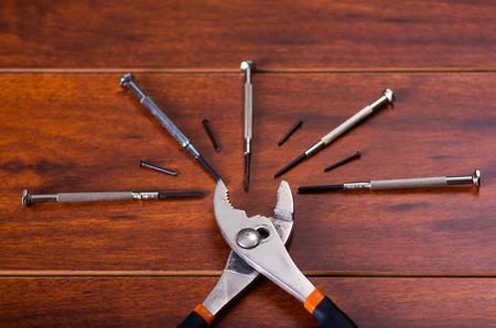 Pliers and construction tools on wooden background Stock Photo