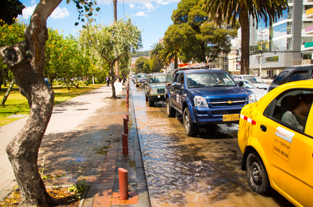 QUITO, ECUADOR - SEPTEMBER 20, 2016: Car rides on a flooded road in Quito city after a heavy rain Editorial