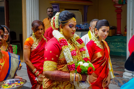 Kuala Lumpur, Malaysia - March 9, 2017: Unidentified people in a traditional Hindu wedding celebration. Hinduism is the fourth largest religion in Malaysia.