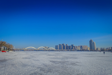 Beautiful view of frozen Songhua river during winter time in Harbin, China