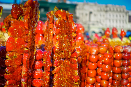 seller: Tomato on a stick, traditional street food in Harbin, China Stock Photo
