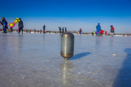 skate park: Harbin, China - February 9, 2017: Spinning top on ice on frozen river Songhua during winter time.