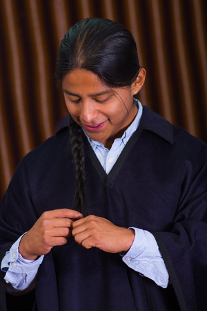 mexican ethnicity: Close up portrait of indigenous young man weaving his hair on a braid