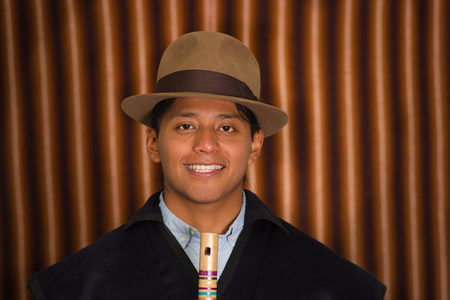 Close up portrait of young man wearing traditional clothes from the highlands in Ecuador