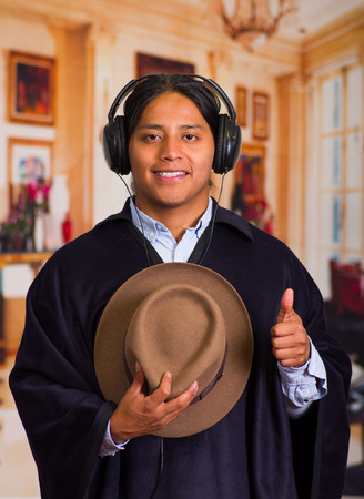 Close up portrait of handsome latin indigenous young man with headphones