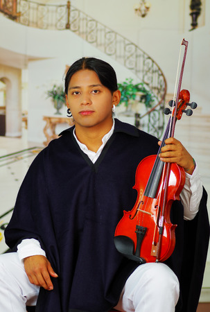 traje mexicano: Indigenous young man from Otavalo, Ecuador, playing the violin