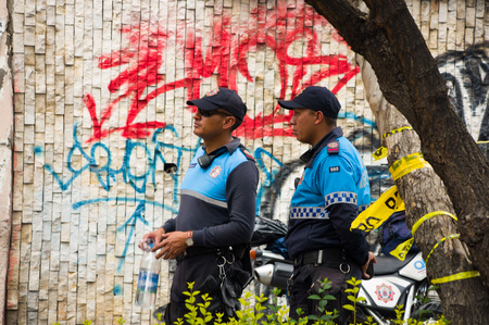 Quito, Ecuador - December 09, 2016: An unidentified police officers on duty in Quito city