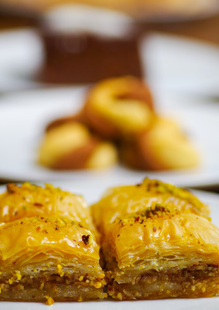 baklava: Close up of a delicious traditional turkish food baklava with pistachio on a white plate in blurred background