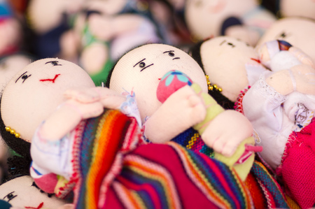OTAVALO, ECUADOR - MAY 17, 2017: Beautiful andean toy textile yarn and woven by hand in wool, in white background