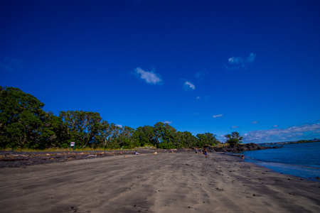 Beautiful view to Rangitoto Island from Karaka Bay Beach Auckland New Zealand in a blue sky in sunny day Stock Photo