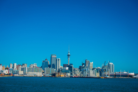 famous industries: AUCKLAND, NEW ZEALAND- MAY 12, 2017: Beautiful view of the largest and most populous urban area of Auckland, in the horizont with a blue sky in a sunny beautiful day