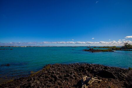 faraway: View of the mainland Auckland city from Rangitoto island