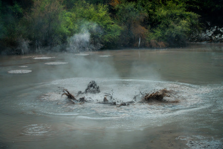 Bubbling Mud releasing Hydrogen Sulphide Gas. Geothermal Activity in Waitapu, New Zealand Stock Photo