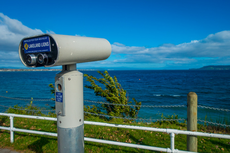 NORTH ISLAND, NEW ZEALAND- MAY 18, 2017: Beautiful viewing on a wharf, and lovely view of Lake Taupo with mountains an city in the background at spring, North Island of New Zealand with beautiful blue sky Editorial