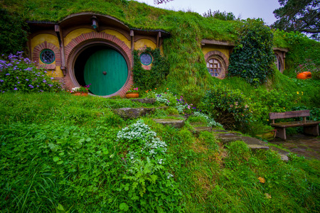 fench: NORTH ISLAND, NEW ZEALAND- MAY 16, 2017: The front gate of Bag End, Hobbiton, the home of key character in the famous movie. Hobbiton is the fictional village created for the movie Lord of the Rings Editorial