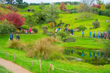 NORTH ISLAND, NEW ZEALAND- MAY 16, 2017: Unidentified people walking in a trail in Hobbiton, hobbiton movie set, site made for movies: Hobbit and Lord of the ring in Matamata, north island of New Zealand Editorial