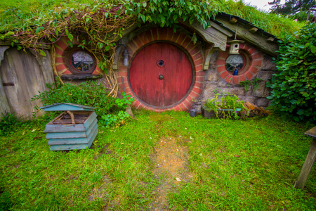 NORTH ISLAND, NEW ZEALAND- MAY 16, 2017: Hobbit house with red door, hobbiton movie set, site made for movies: Hobbit and Lord of the ring in Matamata, north island of New Zealand Editorial