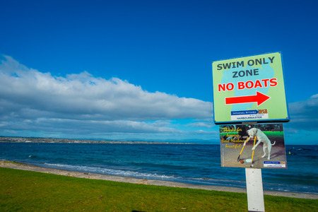 NORTH ISLAND, NEW ZEALAND- MAY 18, 2017: An informative sign of swim only zone not boat located at Taupo,New Zealand