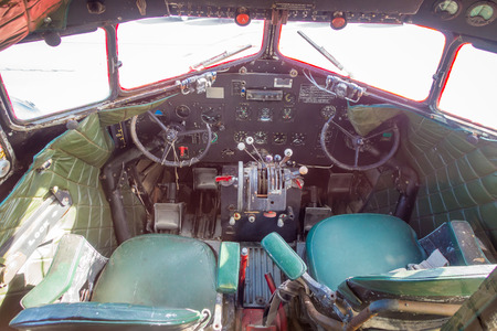 NORTH ISLAND, NEW ZEALAND- MAY 18, 2017: Interior view of the Cockpit from the amazing DC3 plane as part of the McDonalds located at Taupo,New Zealand, and it is 10 coolest McDonalds around the world list Sajtókép